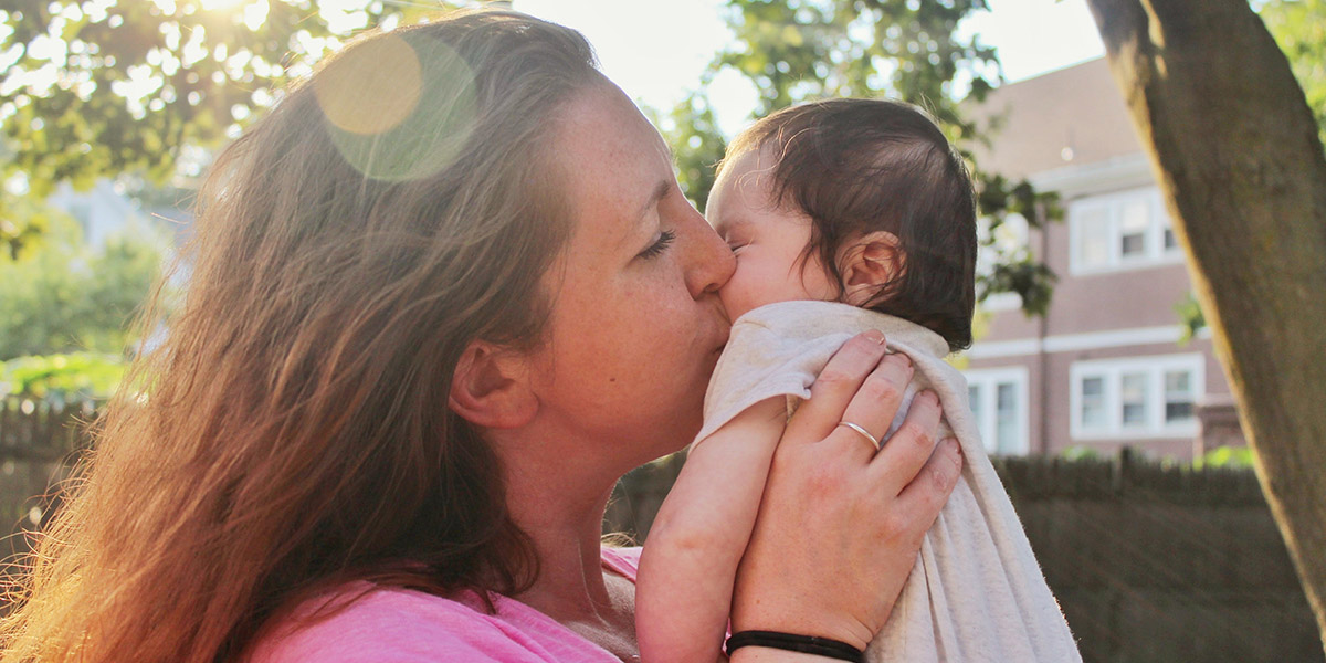Woman kissing infant