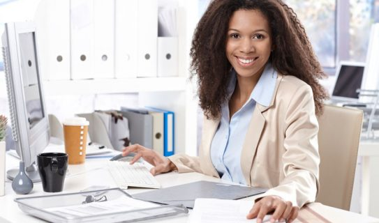 Young woman works at computer