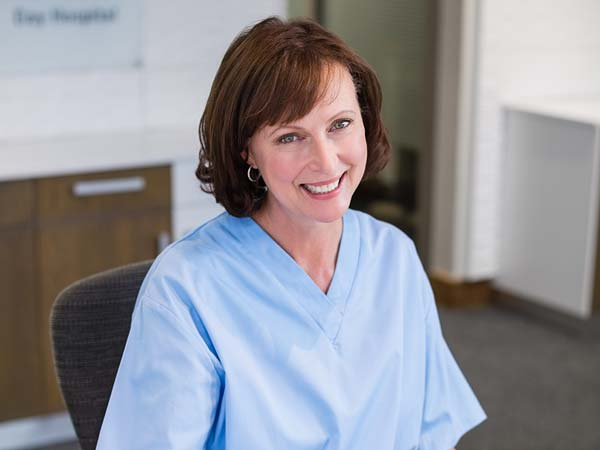 smiling woman in healthcare setting