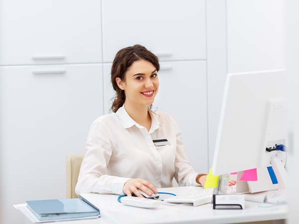 smiling registration clerk in healthcare setting